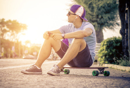 youth sports: skater boy relaxing on His long board