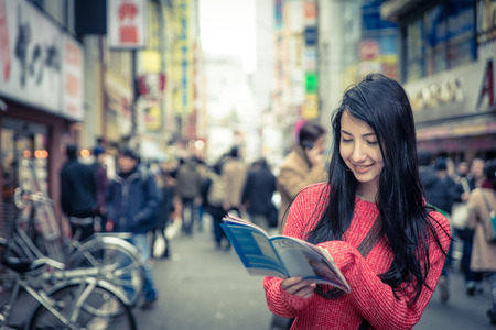 malaysian people: japanese girl with tokyo city map Stock Photo