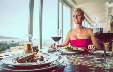 dinner date: Woman dinning in a restaurant