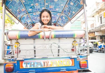 tuk: Asian woman on a taxi tuk tuk in Bangkok,Thailand
