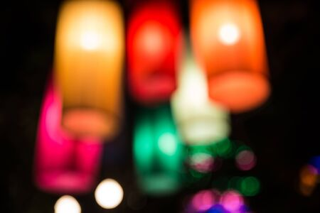 autumn festival: Blurred colored lights - Defocused lanterns hanging on the streets - Colorful background with blurs of lights
