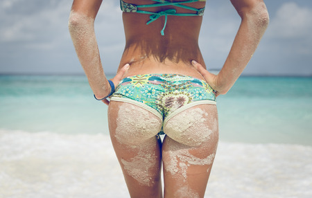 nude female buttocks: young woman buttocks on the beach
