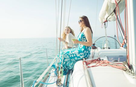 boat party: two young women on the sailing boat