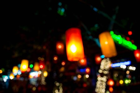 spring in japan: Blurred colored lights - Defocused lanterns hanging on the streets - Colorful background with blurs of lights