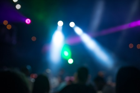 dance club: blurred disco party. defocused concept about disco night party. people dancing in the mix of music and lights Stock Photo