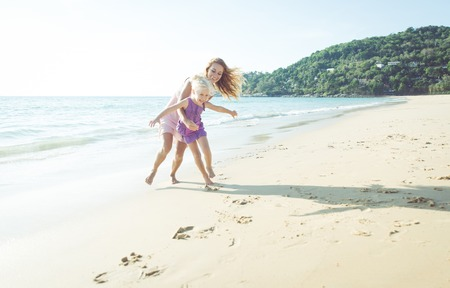 mom: games on the beach. mom and daughter playing together