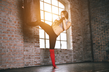 martial arts woman: fighter training Stock Photo