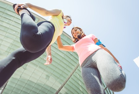 two runners making stretching before running. concept about urban running, sport, fitness and people Stok Fotoğraf