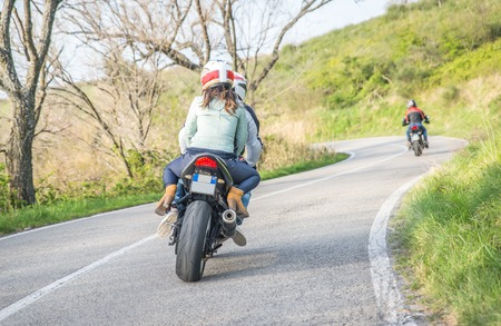motorcycle fare in the weekend. group of friends driving on the sport motorbikes Stock Photo