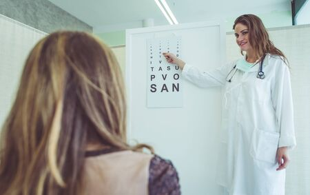 oculist: medical test at the oculist. concept about health care, hospital,clinics and people Stock Photo