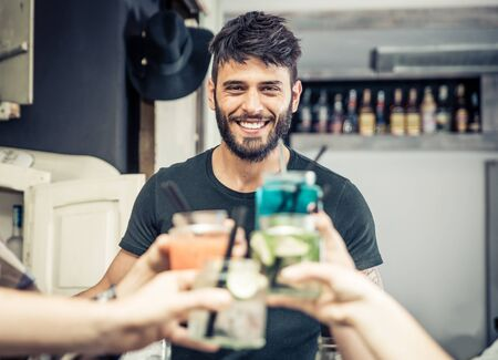 bartender: Smiling bartender with cocktails toast. concept about profession, drinks and fun Stock Photo