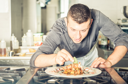 fine fish: Young chef preparing a tasty meal. concept about restaurants and food Stock Photo