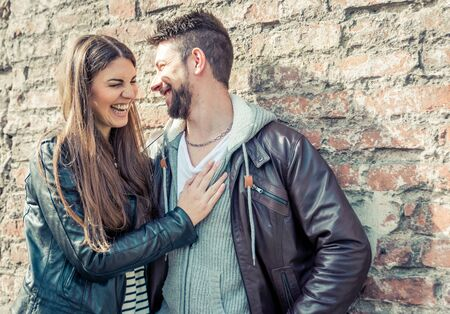 leaning: Couple laughing and having fun. concept about relationships and people Stock Photo