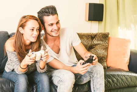 wii: Young couple playing video games at home