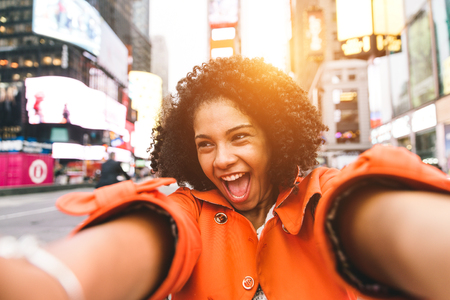new york city times square: afro american woman taking selfie in Time square, New york. crazy portrait in the famous american square