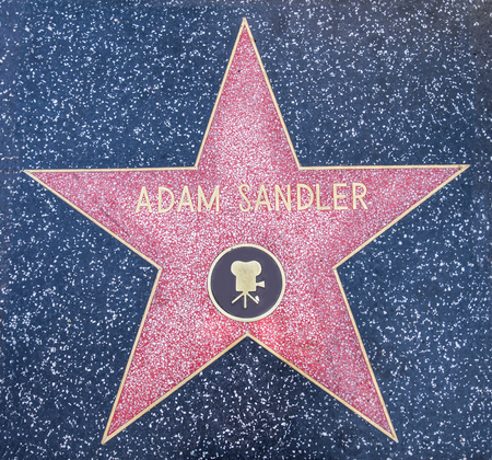 fame: HOLLYWOOD,CA - OCTOBER 8,2015: Adam Sandler star on Hollywood Walk of Fame in Hollywood, California. This star is located on Hollywood Blvd. and is one of 2400 celebrity stars.