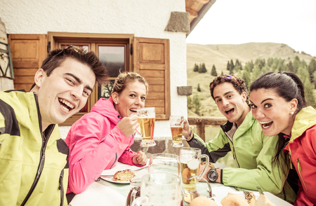 restaurant dining: Group of friends taking selfie during the ski day.