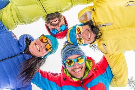 group of persons: Young people on a winter vacation - Tourists having fun while skiing - Concepts about winter,christmas,winter vacation and skiing
