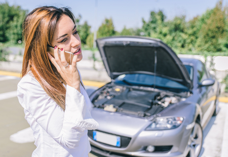 emergency lane: Car breakdown. young woman calling assistance on the phone. Concept about transportation and car breakdown Stock Photo