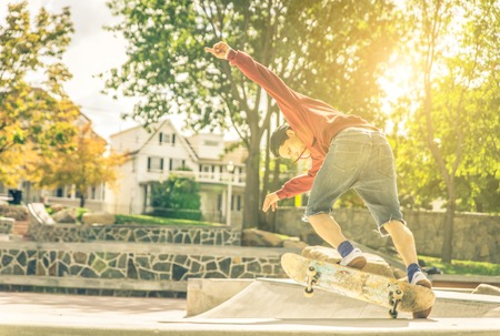 professional practice: Young skateboarder practicing in the skate park in New york city