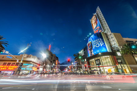 fame: LOS ANGELES - OCTOBER 15, 2015: View of Hollywood Boulevard by night. In 1958, the Hollywood Walk of Fame was created on this street as a tribute to artists working in the entertainment industry.