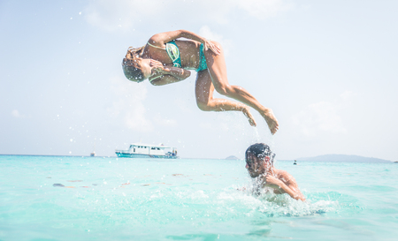 airiness: Couple having fun into beautiful clear water. concept about vacations and fun Stock Photo