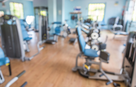 Blurred image of a fitness room. concept about sport, bodybuilding and sport Standard-Bild