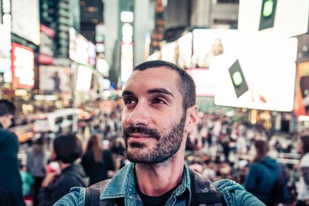 time square: Backpacker tourist taking selfie in Time square, New york