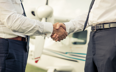 airline pilot: Two pilots shaking hands before the flight