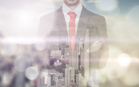 window: Double exposure with business man and city skyline