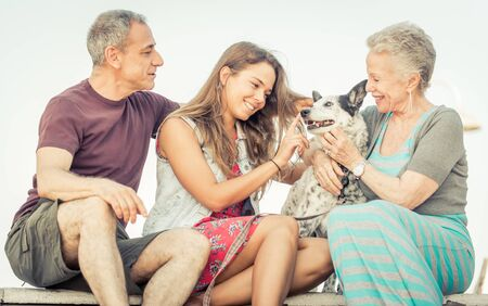 family vacation: Happy family with dog in Santa monica, Los angeles. concept about people, family and happiness