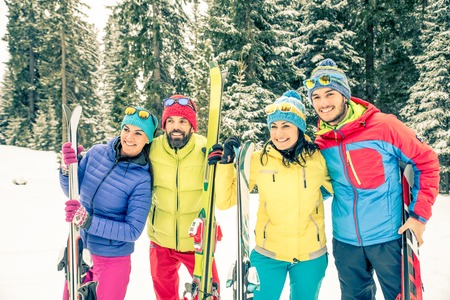 Young people on a winter vacation - Tourists having fun while skiing - Concepts about winter,christmas,winter vacation and skiing