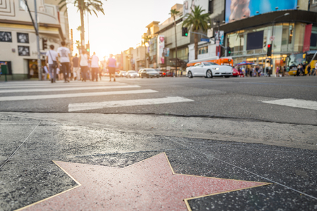 fame: HOLLYWOOD,CA - OCTOBER 11, 2015: Walk of Fame at sunset on Hollywood Boulevard. In 1958, the Hollywood Walk of Fame was created as a tribute to artists working in the entertainment industry.