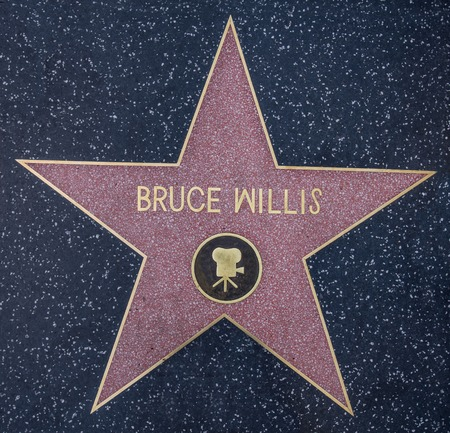 oscar: HOLLYWOOD,CA - OCTOBER 8,2015: Bruce Willis star on Hollywood Walk of Fame in Hollywood, California. This star is located on Hollywood Blvd. and is one of 2400 celebrity stars.