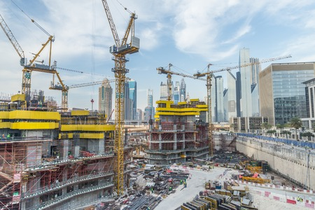 Lots of tower cranes build large residential buildings - Construction site