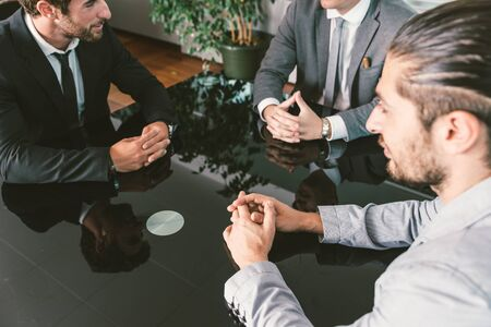employers: Business meeting in the office. manager and employers deciding on the strategy