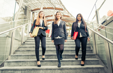 Three business women on the stairs. Business and finance. Concept about career