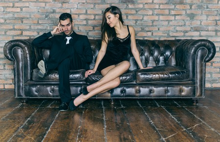sexy lovers: Relationship problems. woman asking forgiveness to her man Stock Photo