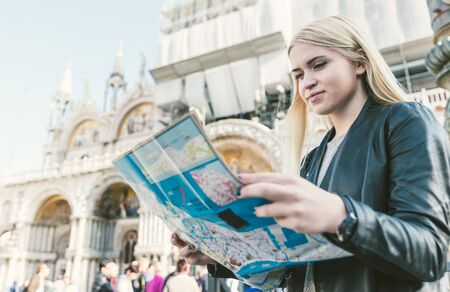 st  mark: Blonde girl checking the map in Venice, st. Mark square