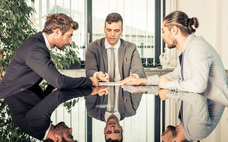 office manager: Business meeting in the office. manager and employers deciding on the strategy