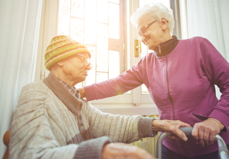old age care: old couple supporting each others Stock Photo