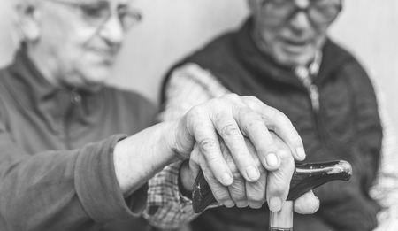 alzheimer: Old couple holding each others hands on the cane