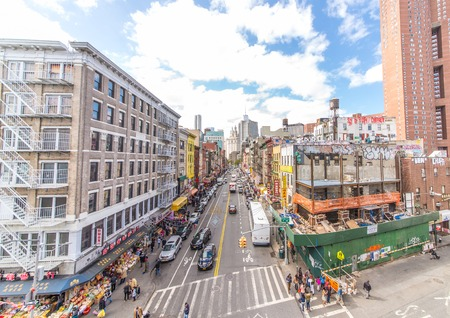 enclave: NEW YORK CITY - OCTOBER 5, 2015: East Broadway in Chinatown in New York, NY. It is the largest and oldest such enclave in the Western Hemisphere with nearly 100,000 residents. Editorial