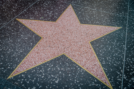 walk of fame: HOLLYWOOD,CA - OCTOBER 8,2015: empty star on Hollywood Walk of Fame in Hollywood, California. This star is located on Hollywood Blvd. and is one of 2400 celebrity stars.