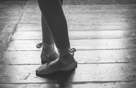 barre: Dancer feet close up. Woman performing ballet poses