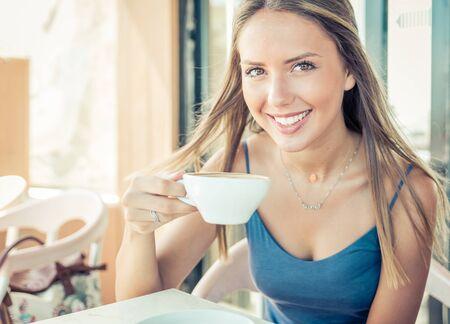 cofee: Beautiful girl drinking cofee in the morning Stock Photo