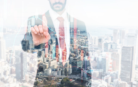Double exposure with business man and city skyline. Man doing forex on a digital chart