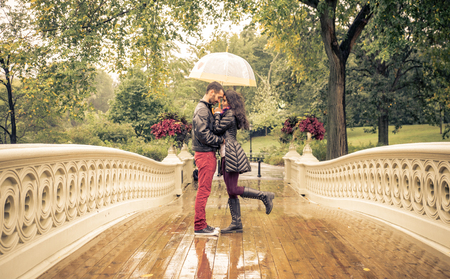 wet men: Lovely couple in Central park, New york under the rain Stock Photo