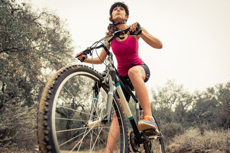 woman sunset: Woman making downhill with mountain bike. Concept about people and sport