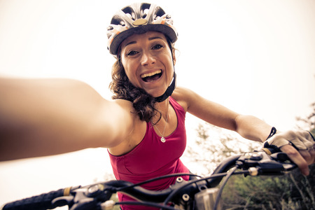 exercise bike: Woman making downhill with mountain bike. Concept about people and sport
